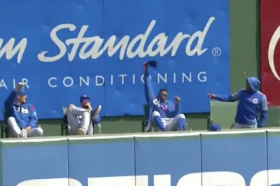 Cubs pitcher catches teammate's homer in hat while sitting in bullpen