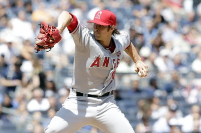 LHP C.J. Wilson making pitch to shift gears and race cars