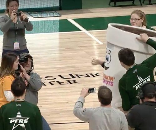 Woman hits half court shot, gets proposal from Dunkin' Donuts mascot