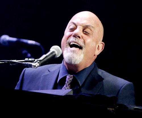 Billy Joel jokes about Christie Brinkley dating John Mellencamp