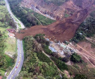 Colombia landslide barrels onto highway; 6 dead, over dozen missing