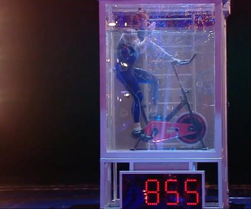 Underwater cyclist on stationary bike travels record 2,800 feet in one breath