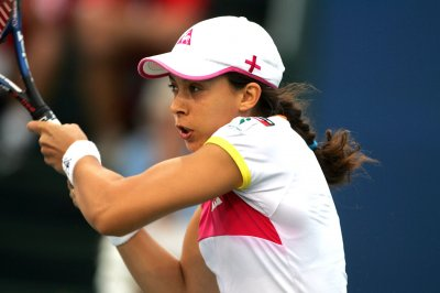 Bartoli wins in day of tennis upsets
