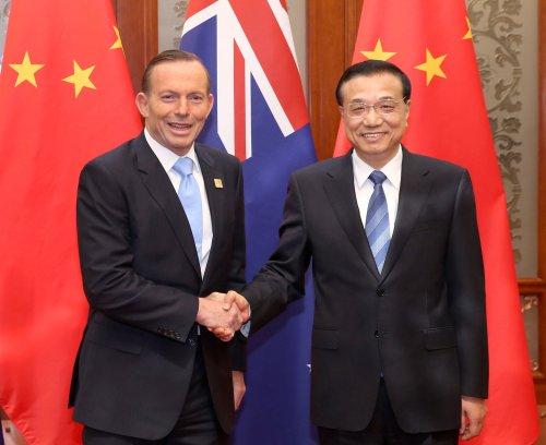 Obama asks Australian P.M. Abbott for bigger effort in Mideast