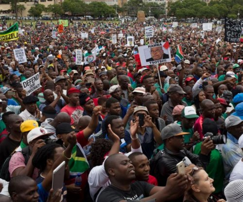 Tens of thousands march against Zuma in South Africa