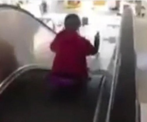 Mall: 'Security guard' in escalator sledding video was part of the prank
