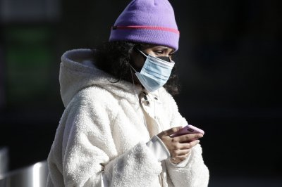 Study shows double-masking -- medical mask under cloth -- cuts COVID-19 spread