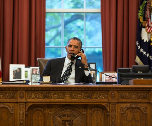 Obama calls into Boston radio show
