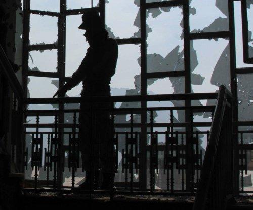 Taliban attack on Kabul police headquarters kills 20