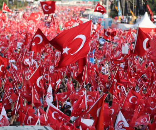 Turkey fires 7,400 civil servants on failed coup's year anniversary
