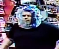 GameStop burglar tries to disguise face with clear plastic