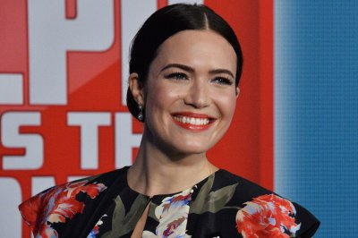 Mandy Moore, Taylor Goldsmith hold hands in wedding photo