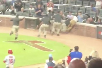 Baseball field invader briefly evades Braves security before taking huge hit