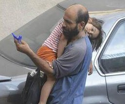 Nearly $100K raised for Syrian father seen in viral photo cradling daughter