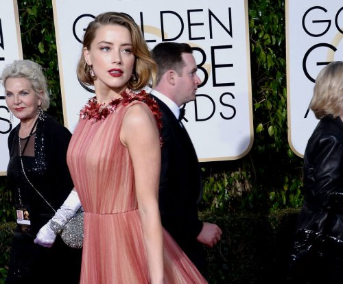 Amber Heard was arrested in 2009 for domestic violence, TMZ reports