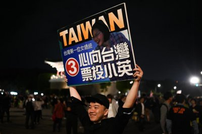 Taiwan President Tsai Ing-wen calls on voters to protect democracy
