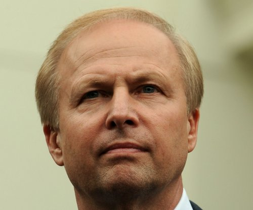 BP pulls reins tighter, freezes pay