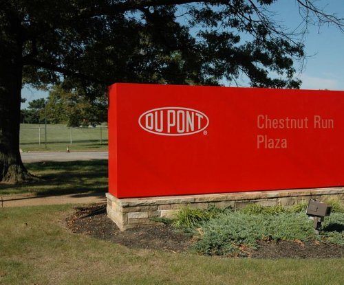 DuPont to end pension contributions, freeze benefit plans