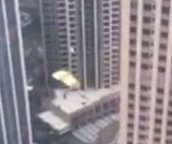 Daredevil BASE jumps from top of 40-story skyscraper in China