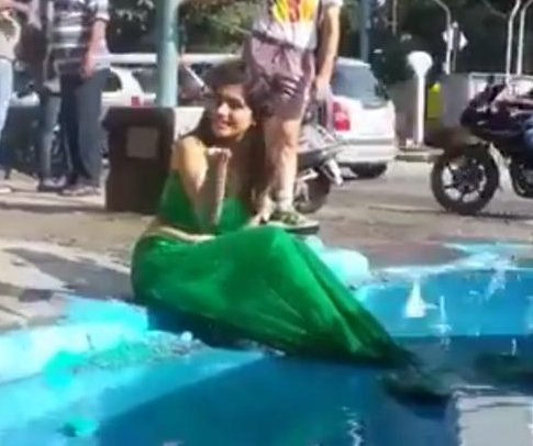 Mermaid draws attention to city's pothole problem