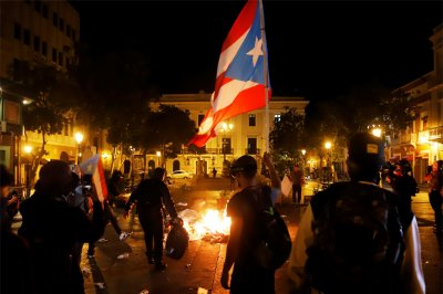 Protesters clash with police in rally against Puerto Rico leader