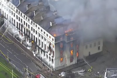 British crews fight major fire at 19th-century seaside hotel
