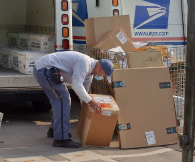 Federal judge rules USPS must expedite mail-in ballots in Detroit and Wisconsin