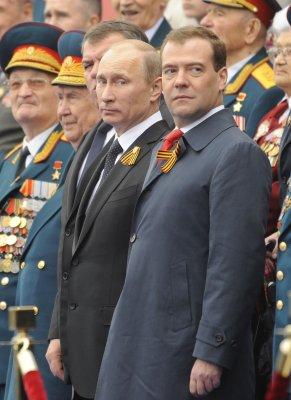 Artist who painted Putin, Medvedev in women's undies flees to France