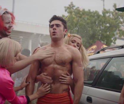 Zac Efron oils up in 'Neighbors 2: Sorority Rising' clip