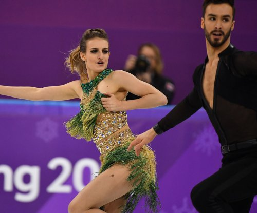 Wardrobe malfunction, world record mark Olympic ice dance