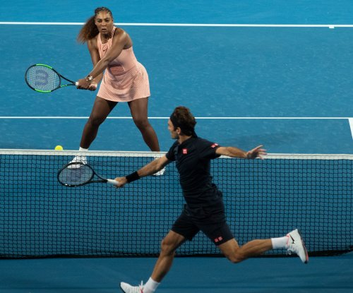Roger Federer beats Serena Williams in doubles match