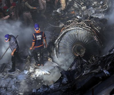 Commercial airliner crashes in Pakistan; dozens dead