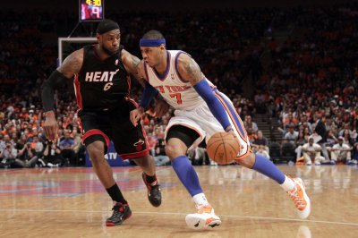 Carmelo Anthony to join LeBron James in Los Angeles; Lakers adding Nunn, Monk