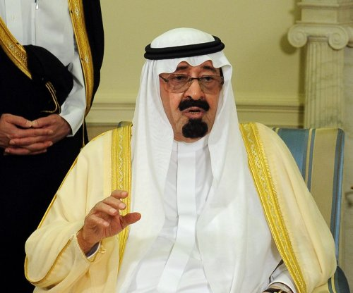 Riyadh holds to oil line, prices drop further