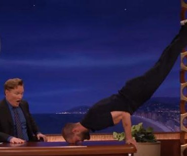 Jamie Dornan recreates Christian Grey's workout routine on Conan O'Brien's desk