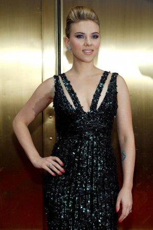 Johansson, Reynolds buy LA home