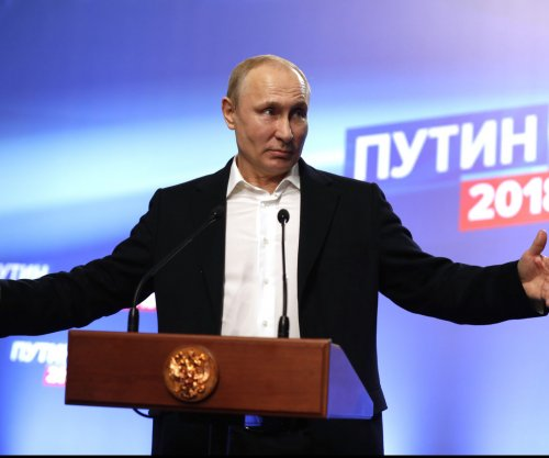 Putin calls for Russian unity after landslide election victory