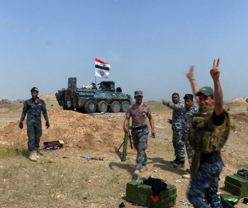 Iraqi PM declares victory, but Tikrit still a battle