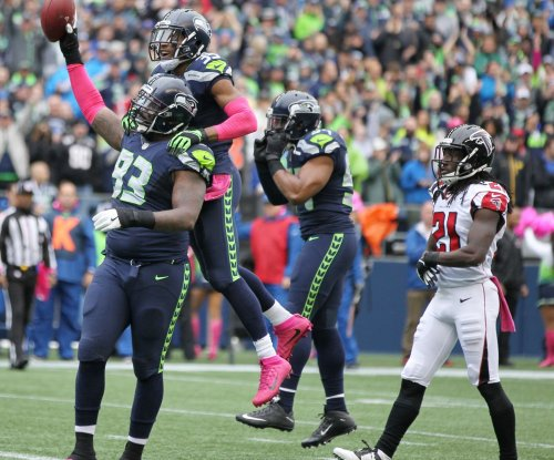 Seattle Seahawks' DeShawn Shead carted off field