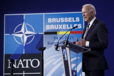 Joe Biden declares 'rock solid' commitment to defend NATO allies