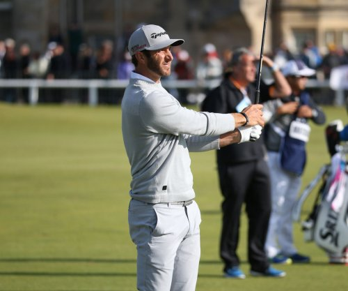 Dustin Johnson maintains lead at rain-delayed Open Championship