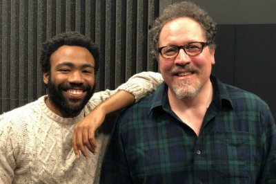 'Lion King': Director Jon Favreau poses with Simba voice actor Donald Glover