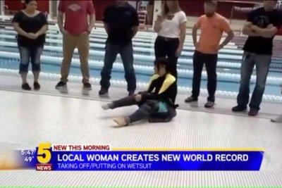 Guinness recognizes Arkansas woman's wet suit dressing record
