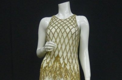 Fifteen of Whitney Houston's gowns and dresses to hit the auction block Nov. 21