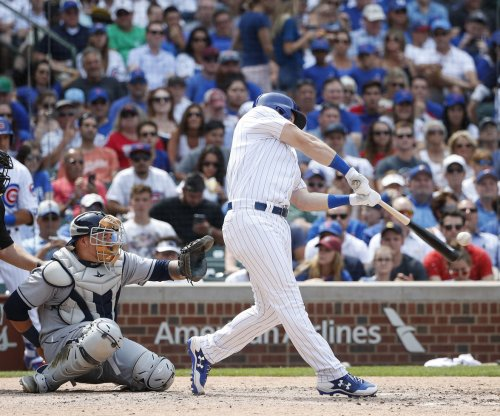 Ian Happ fuels Chicago Cubs' late surge past Tampa Bay Rays