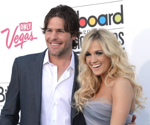 Carrie Underwood celebrates Mike Fisher's retirement: 'So proud!'
