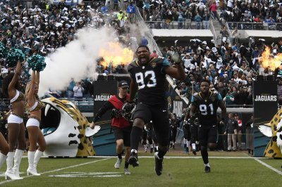 Jacksonville Jaguars exercise DL Calais Campbell's option, decline another