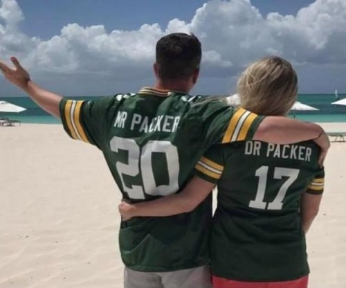 Green Bay football fan becomes 'Packer' by taking wife's last name