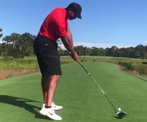 Tiger Woods 'making progress' in new video, sports infamous red polo