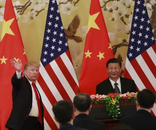 China warns Trump on tariffs, urges 'cooperation'